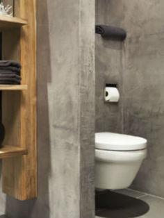 Stoere badkamer met beton en hout